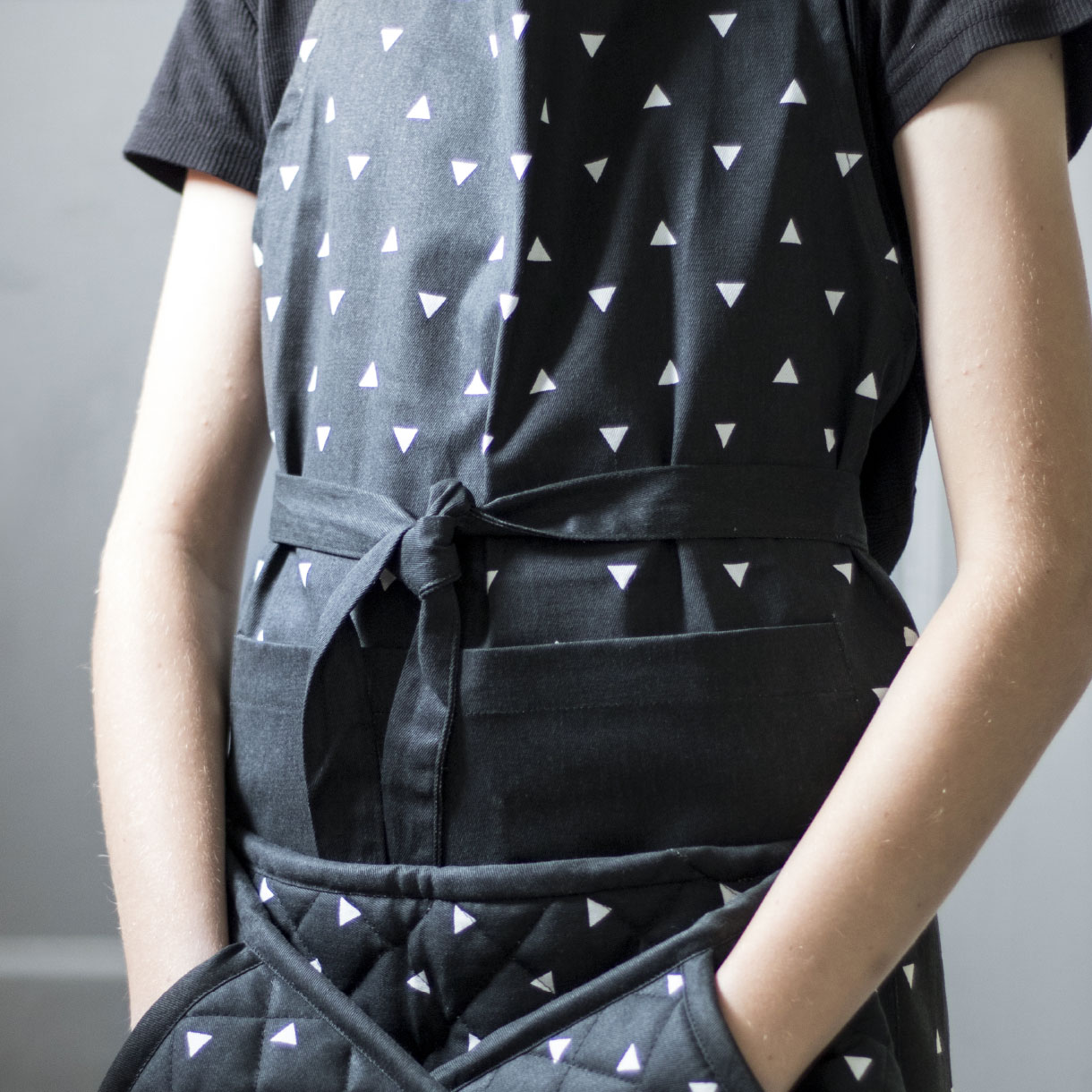 Principle brand agency Dublin Woodie's homewares brand design project scandi collection woman wearing apron